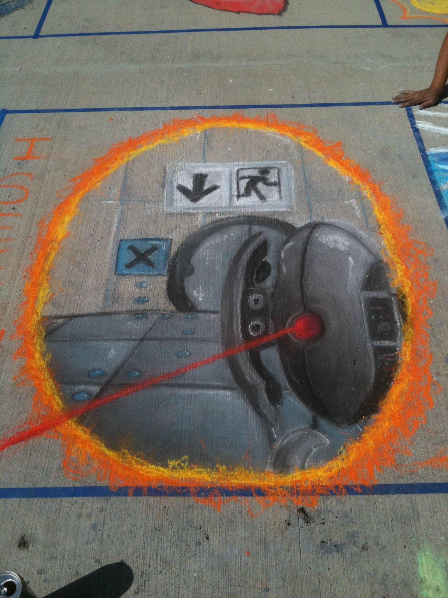 Today my school held an event where students drew on the sidewalks with pastels. One student drew this.