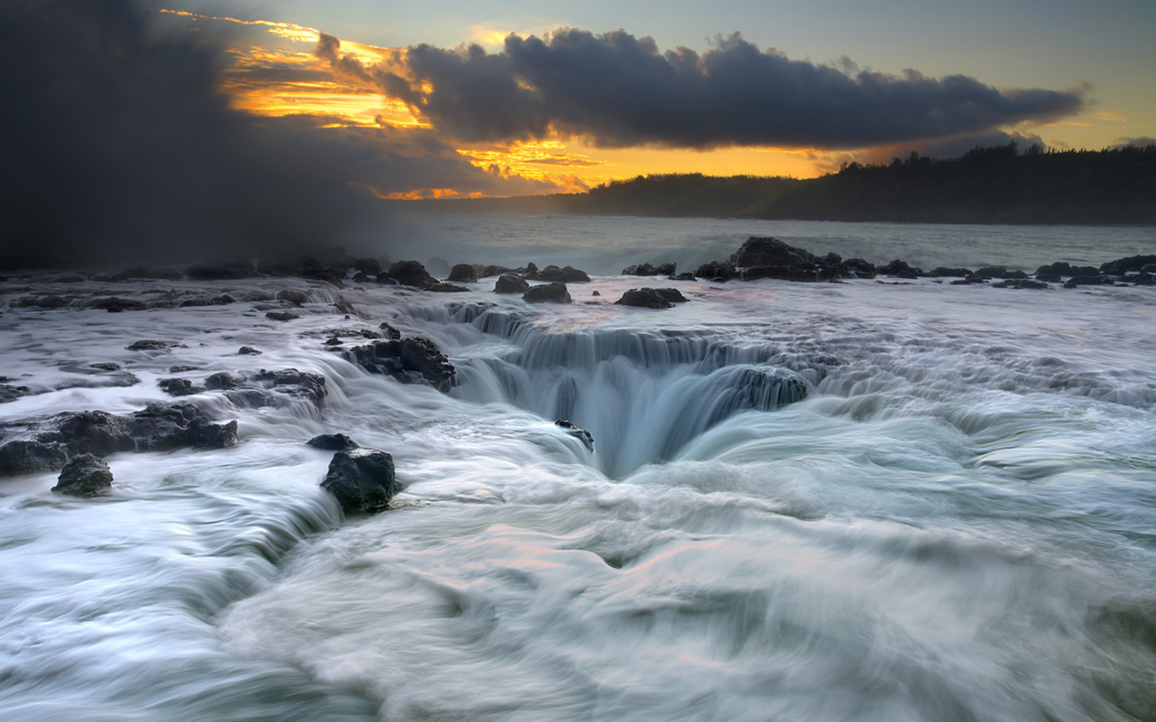 Maelstrom, a natural water drain in Kauai, Hawaii